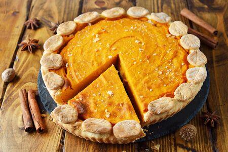 Pumpkin pie on a brown background 写真素材