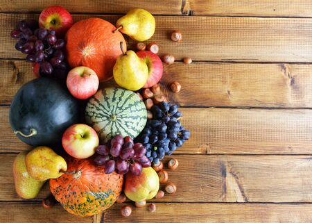 Autumn fruit on a wooden background
