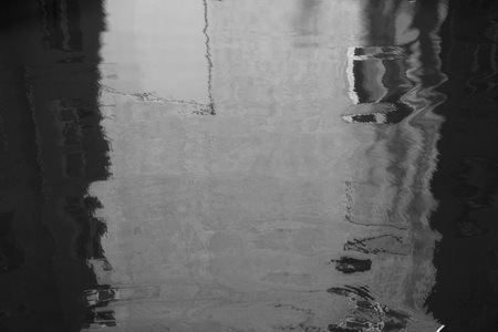 windows frame: Flooded house. Reflection home with windows and trees in puddle. Raining autumn sunny weather. Black and white photo. Rain today. Lines are soft blurred curved wavy. Inverted image