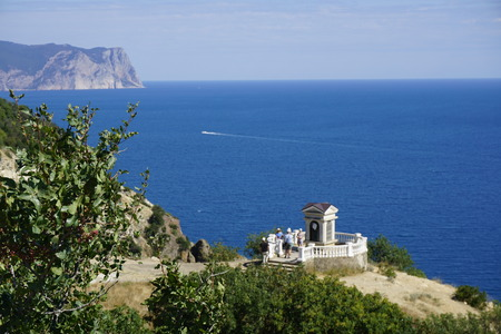 Monastery, Fiolent, Sevastopol, Crimea. Infinity blue Black sea surface with green bushes on foreground. Natural colors photography.
