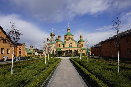 Holosievskaya Pustyn, Kiev (Kyiv), Ukraine. Convent (monastery, church, temple) of orange brick, golden domes with crosses 写真素材