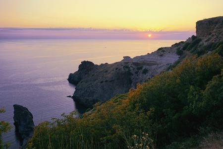 Fiolent, Sevastopol, Crimea, Russia. Sunset time over Black sea. Yellow, purple, lilac colors. Reklamní fotografie