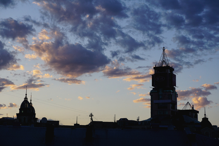 Black silhouette buildings with roof. Kiev, Kyiv, Ukraine. Blue hour, blue clouds on sunset time