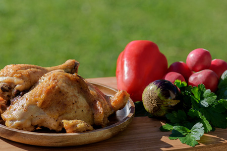 Fried chicken with freshly picked vegetables Stock Photo
