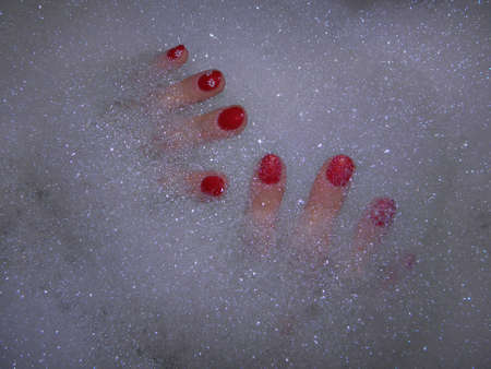 Painted fingernails in the bath foam  photo