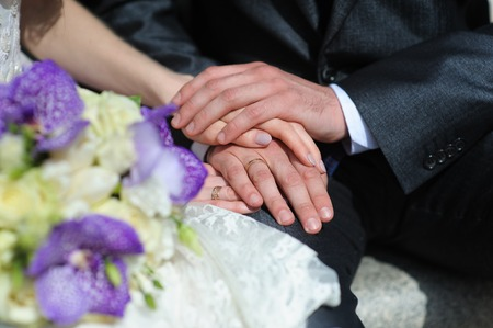 womans hands: Mans and womans hands together.