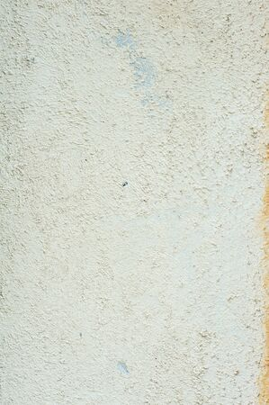 roughly: Beige roughly wall texture. Decorative plaster facade of the building. Old house facade.