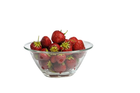 glass plate: Juicy, tasty strawberry on the glass plate. Strawberries in a glass plate on a wooden table. Isolated white background. Fresh strawberries lay on glass plate. Stock Photo