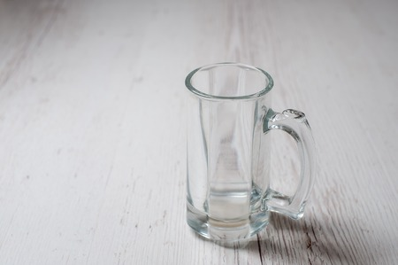 Empty Beer Mug on a light wooden background
