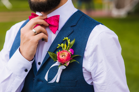 Handsome man, bridegroom close up with pink bow Stock Photo