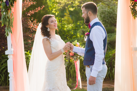 Decorated wedding ceremony in the garden outdoors