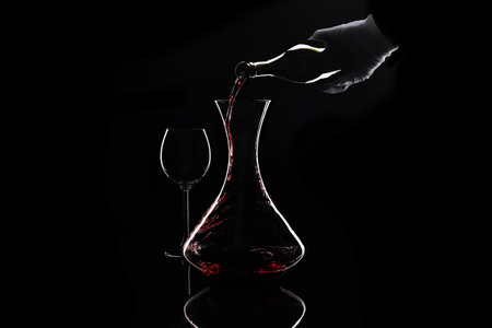 Sommelier pour out red wine from bottle to decanter Stock Photo
