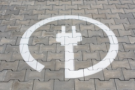 Electric station symbol for electric cars in parking area