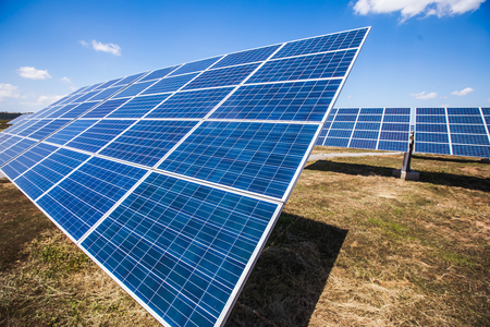Solar power plants, photovoltaic panels arranged in a variety of scenes Stock Photo