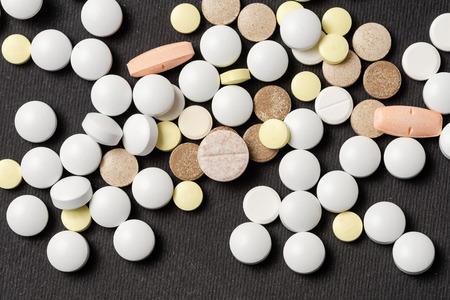 Heap of colorful medication on black background. Imagens