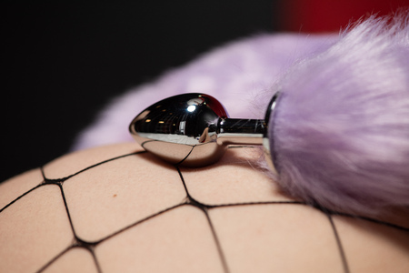 Anal plug device with lilac fur close up