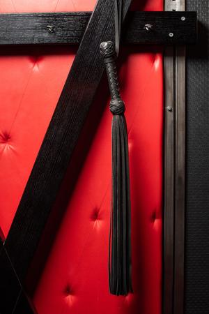 Black leather lash with fringe hanging up
