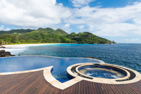 Swimming pool resort surface on Seychelles coast. Beautiful tropical ocean view.