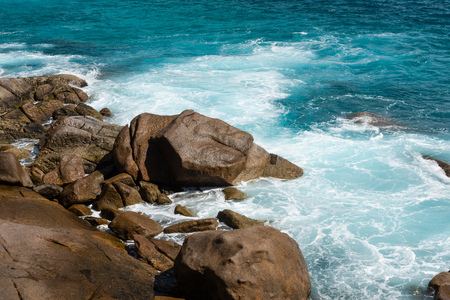 Seychelles windy beach with stones and waves Reklamní fotografie