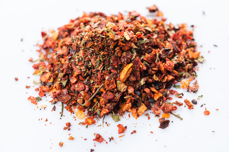 Close-up of Osmanli tatli. Ottoman sweet spices blend on white background. View from above.