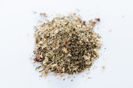 Close-up of greek vegetables spices blend on white background. View from above.