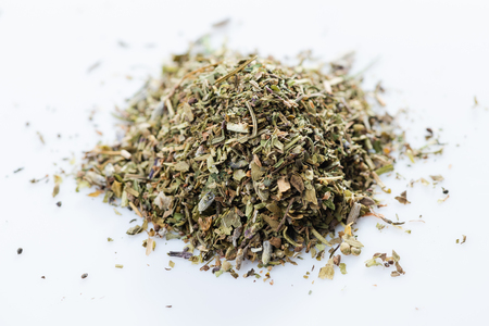Herbes de provence. Close-up of french herbs blend on white background. View from above.