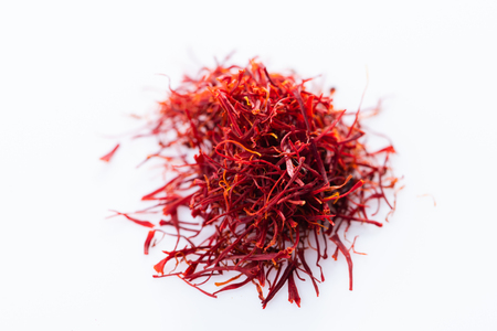 Close-up of saffron spice on white background. View from above.