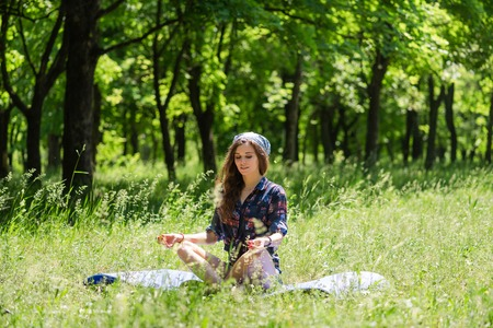 Young woman relax at mat nature background