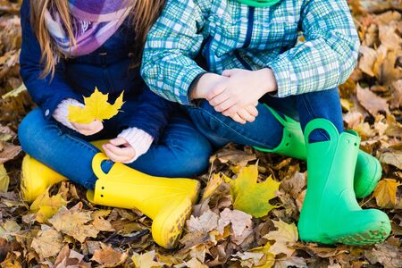 Kids in autumn casual outfit with gumboots Reklamní fotografie