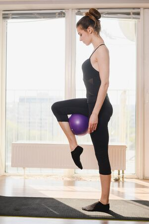 Home sport female training exercise with ball Фото со стока