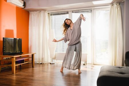 Woman dancing at home at isolation time