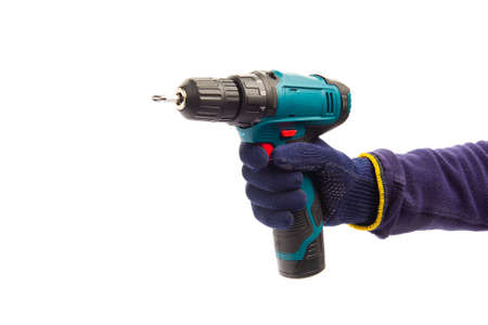 Man wearing blue protective gloves, holding new electric automatic screwdriver at white isolated studio background, renovation, repair tool