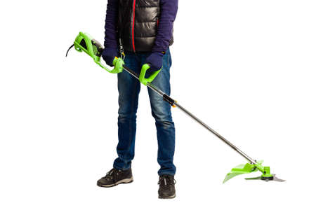 Male hands in gloves with lawn mower trimmer machine at isolated white studio background, gardening tool
