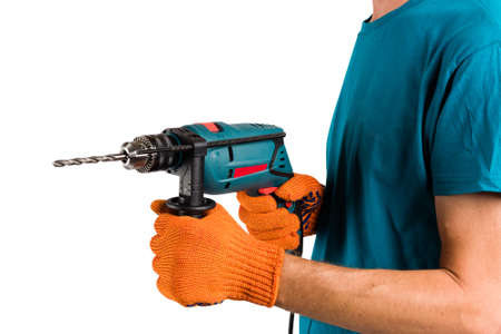 Man in protective gloves change drill in electric perforator at cut out isolated background.