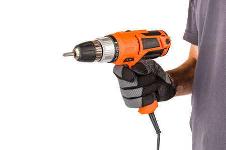 Man wearing protective gloves, holding new electric automatic screwdriver at white isolated studio background, renovation, repair tool.