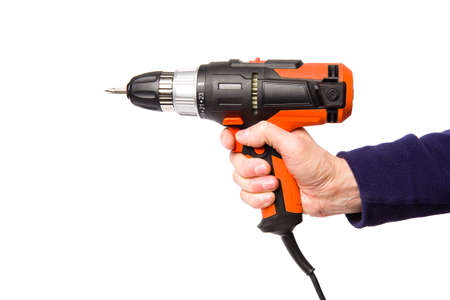 Hand-held electric screwdriver or drill isolated on white background. Banco de Imagens