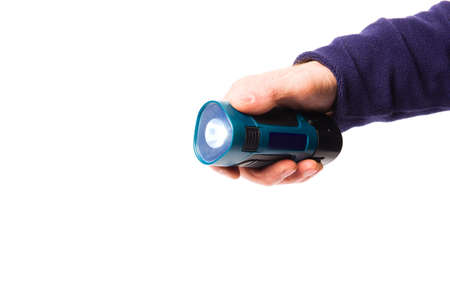 Portable flashlight in a man's hand on a white background