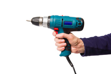 A man's hand holds an electric screwdriver isolated on white background, close-up. Banco de Imagens