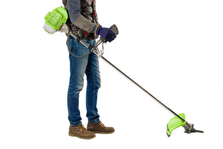 Man with garden trimmer isolated on white background.