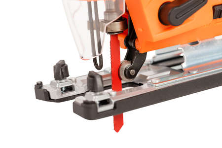 Close-up of electric jigsaw for wood sawing on white background. Banco de Imagens