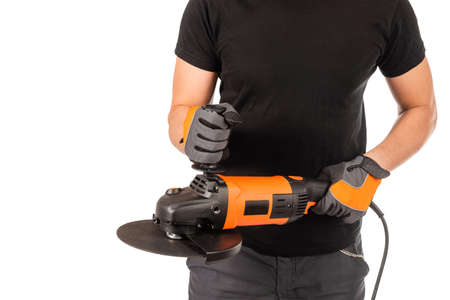 A man holds an angle grinder in his hands, white background.