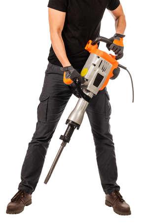 Man holds a jackhammer on a white background Banco de Imagens