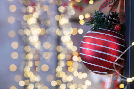 Christmas and New year holiday decoration ornament red ball with pine cones and light garland bokeh at background 스톡 콘텐츠
