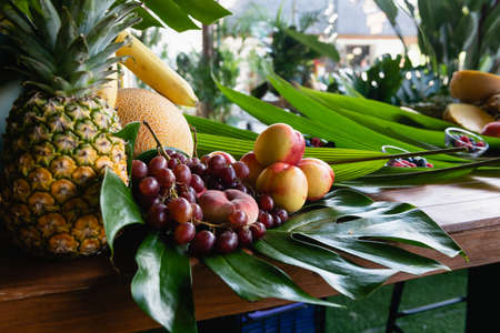 Fruit hotel buffet decorated with green leaves