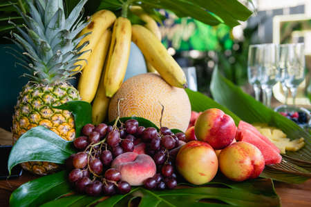 Fruits selection at buffet with exotic leaves 스톡 콘텐츠