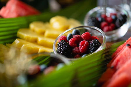 Close up berries in bowls at buffet 스톡 콘텐츠