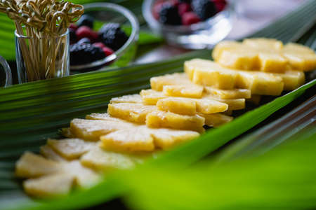 Close up fresh pineapple slices on leaf