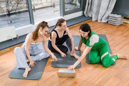Sports women sit in sportswear with laptop