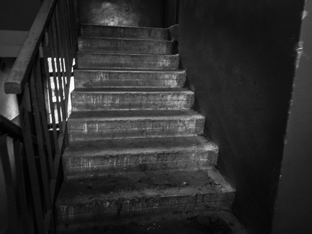 Black and white photograph of the old cement stairs up.