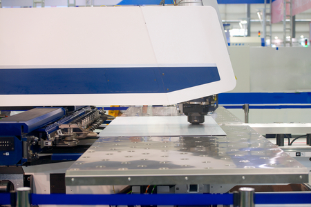 High precision CNC sheet metal stamping and punching machinery on exhibition photo